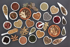 Health Food for Women. Health food with herb and spice selection for womens health over grey background stock image