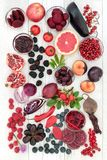 Health Foods High in Anthocyanins. Health food concept with fruit and vegetables high in anthocyanins, antioxidants and vitamins on rustic wood background. Red royalty free stock images