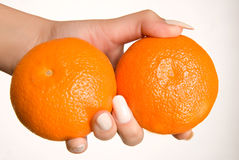 Health and fun. Two colorful oranges in the hand Royalty Free Stock Images