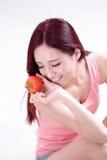 Health girl show tomato Stock Photos