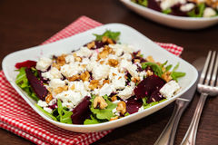 Health-giving beet salad. Close-up health-giving beet salad with arugula, feta cheese and walnut royalty free stock image