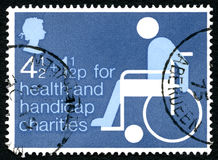 Health and Handicap Charities UK Postage Stamp. GREAT BRITAIN - CIRCA 1975: A used postage stamp from the UK, promoting Health and Handicap Charities, circa 1975 Stock Photography