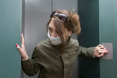 Health Hazard. Teenager putting on a face mask stock images