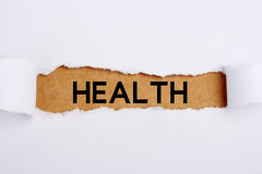 Health Headline. Headline Health on brown paper under white tear drop Royalty Free Stock Images
