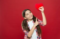 Health and healthcare. Having heart problem and heartache. Small girl pointing finger at red heart. Little child. Expressing love on valentines day. Cute girl royalty free stock images