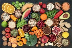 Health for for a Healthy Life. Health food concept with fruit, vegetables, seeds, pulses, grains, cereals, herbs and spices with foods high in vitamins, minerals Stock Image