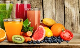 Various healthy juices on table. Health healthy various juices natural food eating healthy table Royalty Free Stock Images