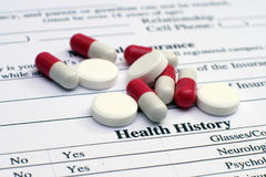 Health history and pills Royalty Free Stock Images