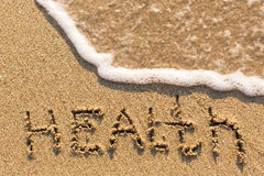Health - inscription on sand beach Stock Image