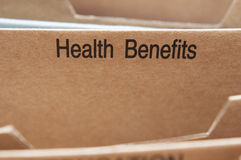Health Insurance. Benefits section tab in folding file Stock Photography