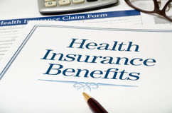 Health Insurance Benefits book close-up Royalty Free Stock Photo