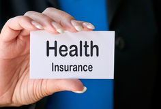 Health insurance business card. Hand of woman with health insurance business card Stock Images