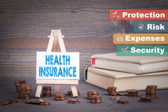 Health Insurance, Business Concept. Miniature easel with small change Stock Images