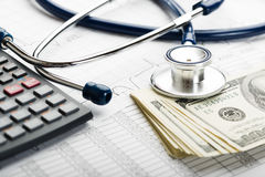 Health insurance. Health care costs. Stethoscope and calculator symbol for health care costs or medical insurance Royalty Free Stock Photos