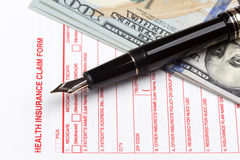 Health insurance claim form. With fountain pen Royalty Free Stock Images