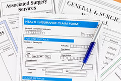 Health Insurance Claim Form with Invoices. For Surgery Royalty Free Stock Images