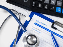 Health insurance claim form. The insurance policy covers the cost of treatment. Healthcare, medical treatment, health insurance, settlement and safety concept royalty free stock photo