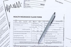 Health Insurance Claim Form with Silver Pen Royalty Free Stock Photo
