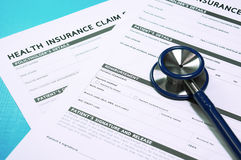 Health insurance claim form with stethoscope Stock Images