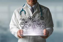 Doctor with Health Insurance Modern Interface Icon. Health Insurance Concept - Doctor in hospital with health insurance related icons in modern graphic interface Royalty Free Stock Photos