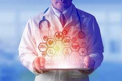 Doctor with Health Insurance Modern Interface Icon. Health Insurance Concept - Doctor in hospital with health insurance related icons in modern graphic interface Stock Image