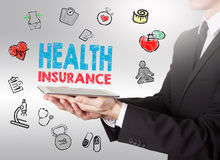 Health insurance concept. Healty lifestyle background. Man holdi Stock Photography
