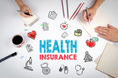 Free Health Insurance Concept. Healty Lifestyle Background. The Meeting At The White Office Table Stock Image - 82518621