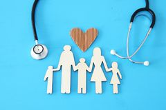Health Insurance . concept image of Stethoscope and family on wooden table. top view. Health Insurance . concept image of Stethoscope and family on wooden table royalty free stock image