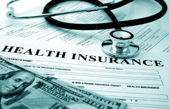 Health insurance. Form with money and stethoscope Royalty Free Stock Photography