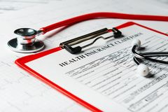 Health insurance form with stethoscope concept. For life planning stock photography