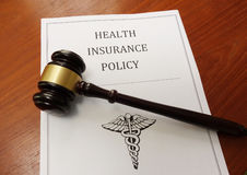 Health insurance law. Health insurance policy and legal gavel Royalty Free Stock Photo