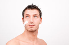 Health insurance man with plaster aid Stock Photography