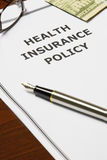 Health Insurance Policy. Image of a health insurance policy on an office table Royalty Free Stock Photos