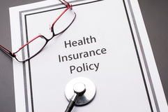 Health Insurance Policy. On business table Royalty Free Stock Photos