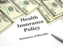 Health Insurance Policy and Cash Royalty Free Stock Photos