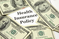 Health Insurance Policy costs cash Royalty Free Stock Photo