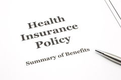 Health Insurance Policy with Pen Royalty Free Stock Photo