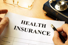 Health insurance policy. Health insurance policy on a table Royalty Free Stock Photo