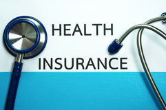 Health insurance with stethoscope Stock Images
