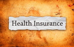 Health insurance title on old paper Stock Image