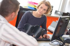 Health insurance worker meeting client in office. Client stock image
