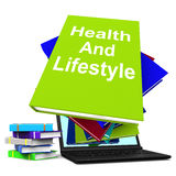 Health and Lifestyle Book Stack Laptop Shows Healthy Living Stock Images