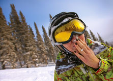 A health lifestyle image of young adult snowboarder with wet fac Stock Photography