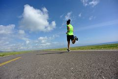Lifestyle woman trail runner running on country road Stock Photography