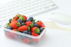 Health lunch with strawberry and blueberry mix Stock Photo