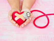 Health and medical, love and valentine concept. Red heart on a w stock photos