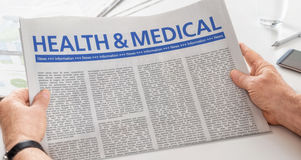 Health and Medical. Man reading newspaper with the headline Health and Medical Stock Photos
