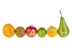 Health and nutrition. The word HEALTH cut in to six different fruits stock images
