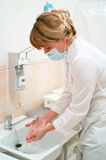 Health occupation worker washing her hands Royalty Free Stock Image