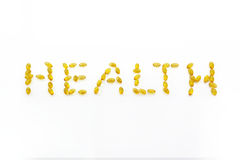 Health, omega 3. Health letter, A word from beautiful yellow Cod liver oil Omega 3 gel capsules isolated on white background Stock Photo